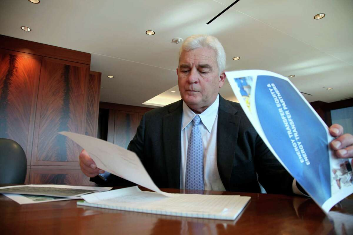 Energy Transfer CEO Kelcy Warren reviews documents about the Dakota Access Pipeline, the oil pipeline mired in controversy after thousand of protestors have sought to block its expansion underneath a water source close to the Standing Rock Sioux Indian Reservation, Friday, Nov. 18, 2016, in Dallas. (AP Photo/ John L. Mone)