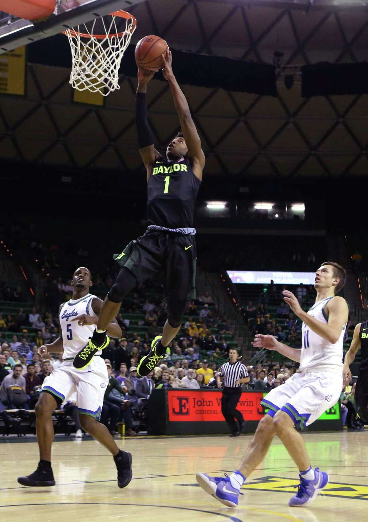 Baylor guard Wendell Mitchell dunks in the Bears' victory over Florida Gulf Coast on Friday night in Waco.