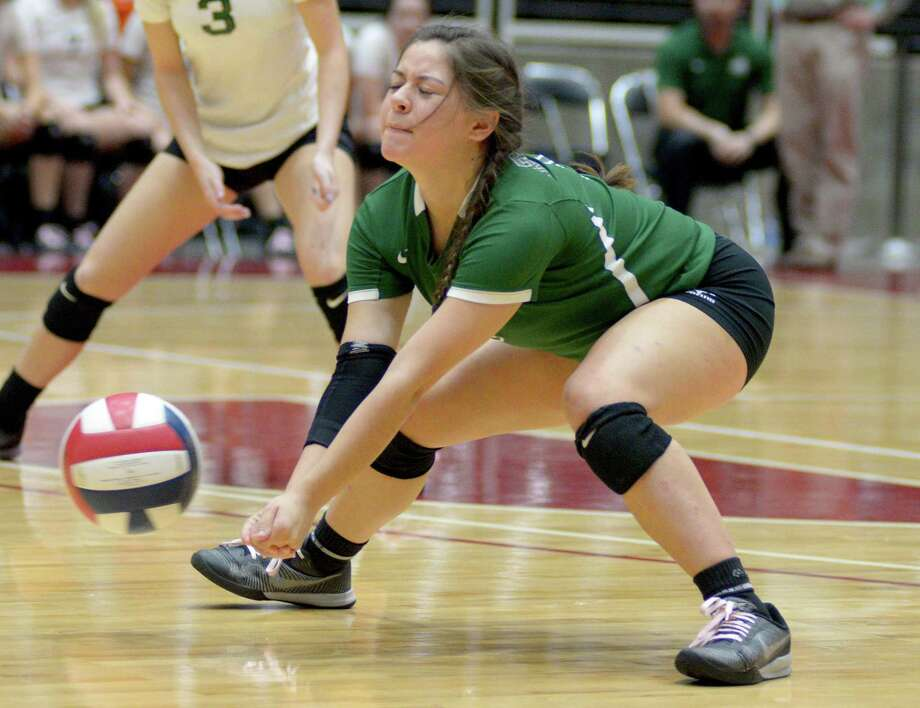 Reagan's Lydia Niebla goes for a dig during the state tournament semifinal match against League City Clear Creak on Oct. 18, 2016, in Garland. Photo: Matt Strasen /For The Express-News / Matt Strasen