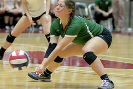 Reagan's Lydia Niebla goes for a dig during the state tournament semifinal match against League City Clear Creak on Oct. 18, 2016, in Garland.