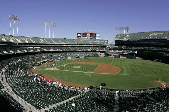 """FILE - This Sept. 30, 2007 file photo shows O.Co Coliseum, then called McAfee Coliseum, home of the Oakland Athletics baseball team, in Oakland, Calif. Major League Baseball is dragging its feet on having team owners vote on the Athletics' proposed move to a new ballpark 40 miles south in San�Jose, San�Jose city officials said in a lawsuit filed Tuesday, June 18, 2013. The lawsuit � filed in federal court in San�Jose � is disputing MLB's exemption to federal antitrust law, which MLB has used as a """"guise"""" to control the location of teams, according to the suit. (AP Photo/Eric Risberg, File)"""