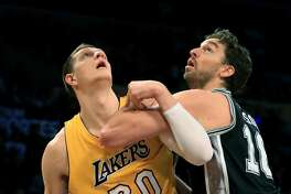 LOS ANGELES, CA - NOVEMBER 18:  Timofey Mozgov #20 of the Los Angeles Lakers battles Pau Gasol #16 of the San Antonio Spurs for postion during the first half of a game at Staples Center on November 18, 2016 in Los Angeles, California. NOTE TO USER: User expressly acknowledges and agrees that, by downloading and or using this photograph, User is consenting to the terms and conditions of the Getty Images License Agreement  (Photo by Sean M. Haffey/Getty Images)