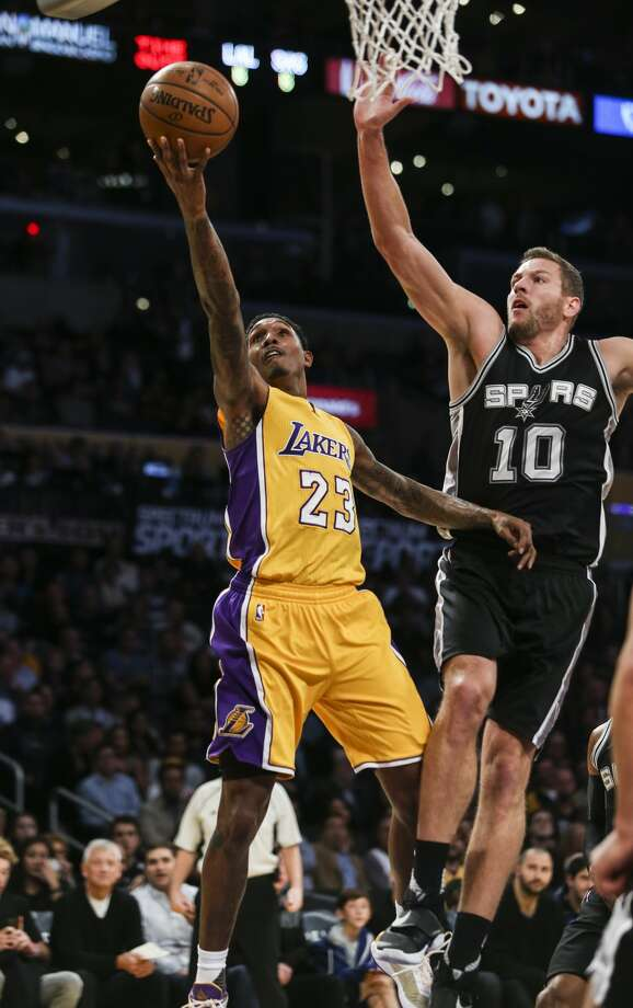 Los Angeles Lakers guard Lou Williams goes up for a layup while defended by San Antonio Spurs forward David Lee during the first half of an NBA basketball game Friday, November 18, 2016, in Los Angeles. (AP Photo/Ringo H.W. Chiu) Photo: Ringo H.W. Chiu/Associated Press
