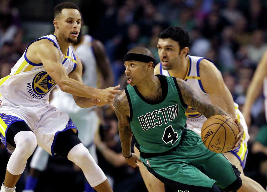 Boston Celtics guard Isaiah Thomas (4) looks for room to drive against Golden State Warriors guard Stephen Curry, left, and center Zaza Pachulia, right, in the third quarter of an NBA basketball game, Friday, Nov. 18, 2016, in Boston. (AP Photo/Elise Amendola) ORG XMIT: MAEA109 Photo: Elise Amendola / AP