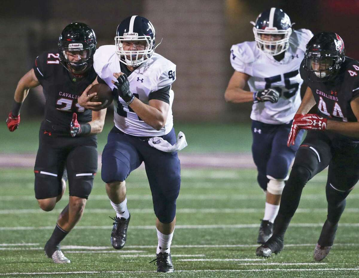 Rangers quarterback Josh Adkins takes off on a long gain in the first quarter as Smithson Valley plays Lake Travis in the Class 6A Division I second round playoffs at Bobcat Stadium in San Marcos on November 18, 2016.