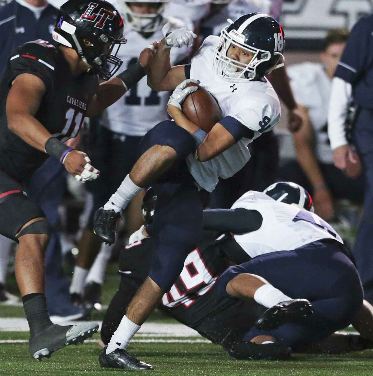Josh Dillon pivots away from tacklers on a long gain in the second half as Smithson Valley plays Lake Travis in the Class 6A Division I second round playoffs at Bobcat Stadium in San Marcos on November 18, 2016.