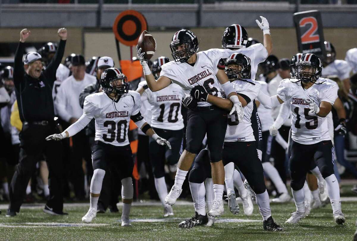 Churchill's Grant Gomez (26) celebrates with teammates after picking off a pass late in the fourth quarter against Brennan during their second-round Class 6A Div. II playoff game at Farris Stadium on Friday, Nov. 18, 2016. Chargers defeated the Bears, 10-7, to advance. (Kin Man Hui/San Antonio Express-News)