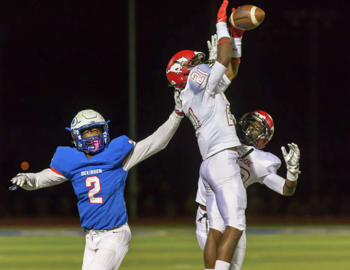 North Shore's Matthew Stephenson intercepts a pass in the fourth quarter of the Class 6A Division I Region III area-round game against Dickinson at Sam Vitanza Stadium on Friday night.