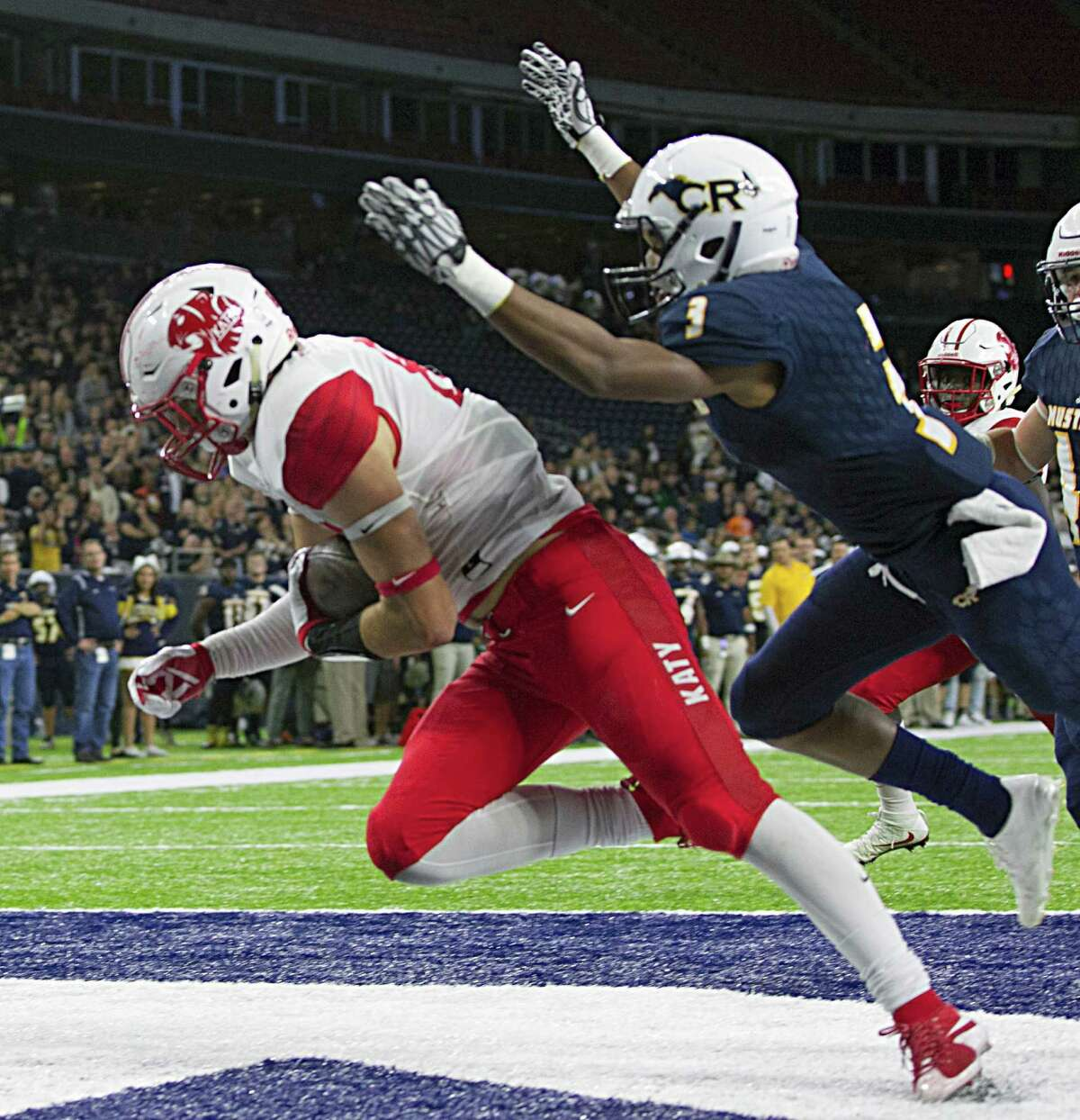 Katy's Parker Eichenberger left, scores a touchdown against Cypress Ranch's Shemar Barthlomew during the first half of the Class 6A Division I playoffs Friday at NRG Stadium.
