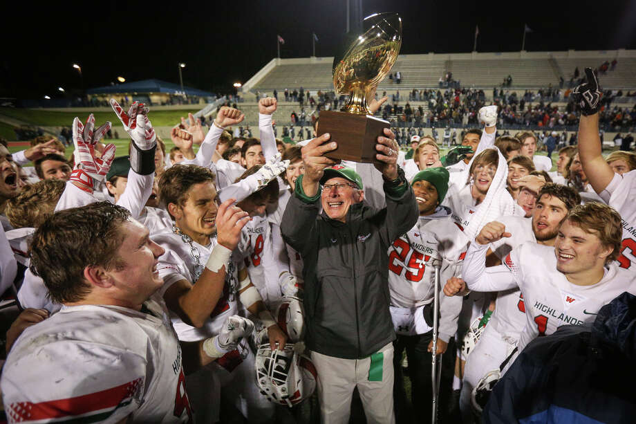 The Woodlands head coach Mark Schmid lifts a trophy after the Highlanders won an area round playoff game against Sachse on Friday, Nov. 18, 2016, in Waco, Texas. (Michael Minasi / Chronicle) Photo: Michael Minasi, Staff / © 2016 Houston Chronicle