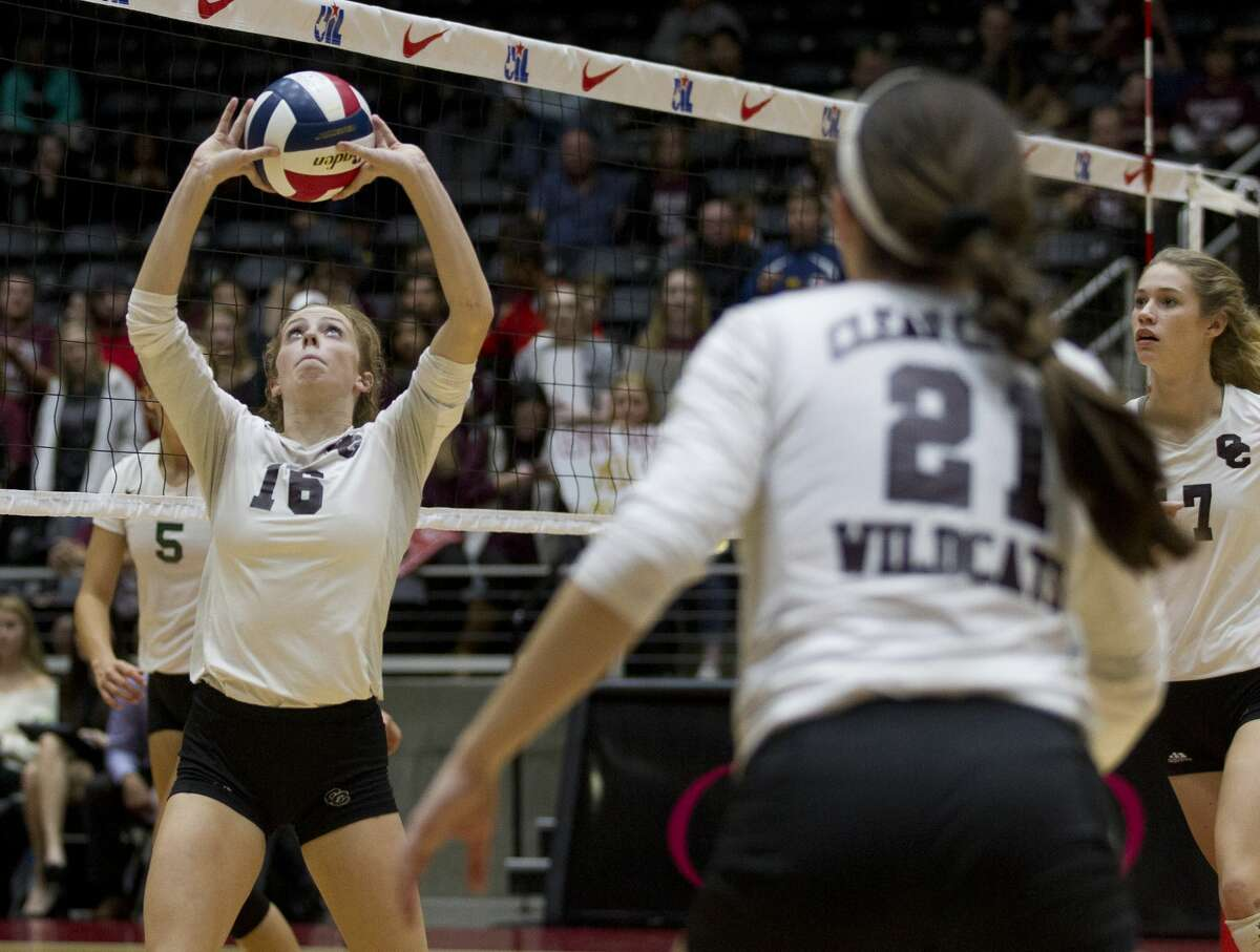 Clear Creek's Kelsey Childers (16) sets the ball in the third set of a Class 6A state semifinal match during the UIL State Volleyball Championships at the Curtis Culwell Center Friday, Nov. 18, 2016, in Garland. Clear Creek defeated San Antonio Reagan in staight sets.