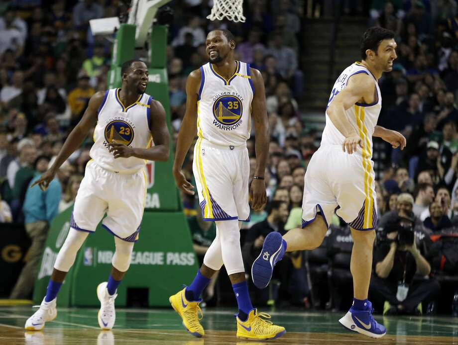 Warriors forward Kevin Durant (35) needed only 13 shots to finish with 23 points, 10 rebounds, seven assists and three steals. Photo: Elise Amendola, Associated Press