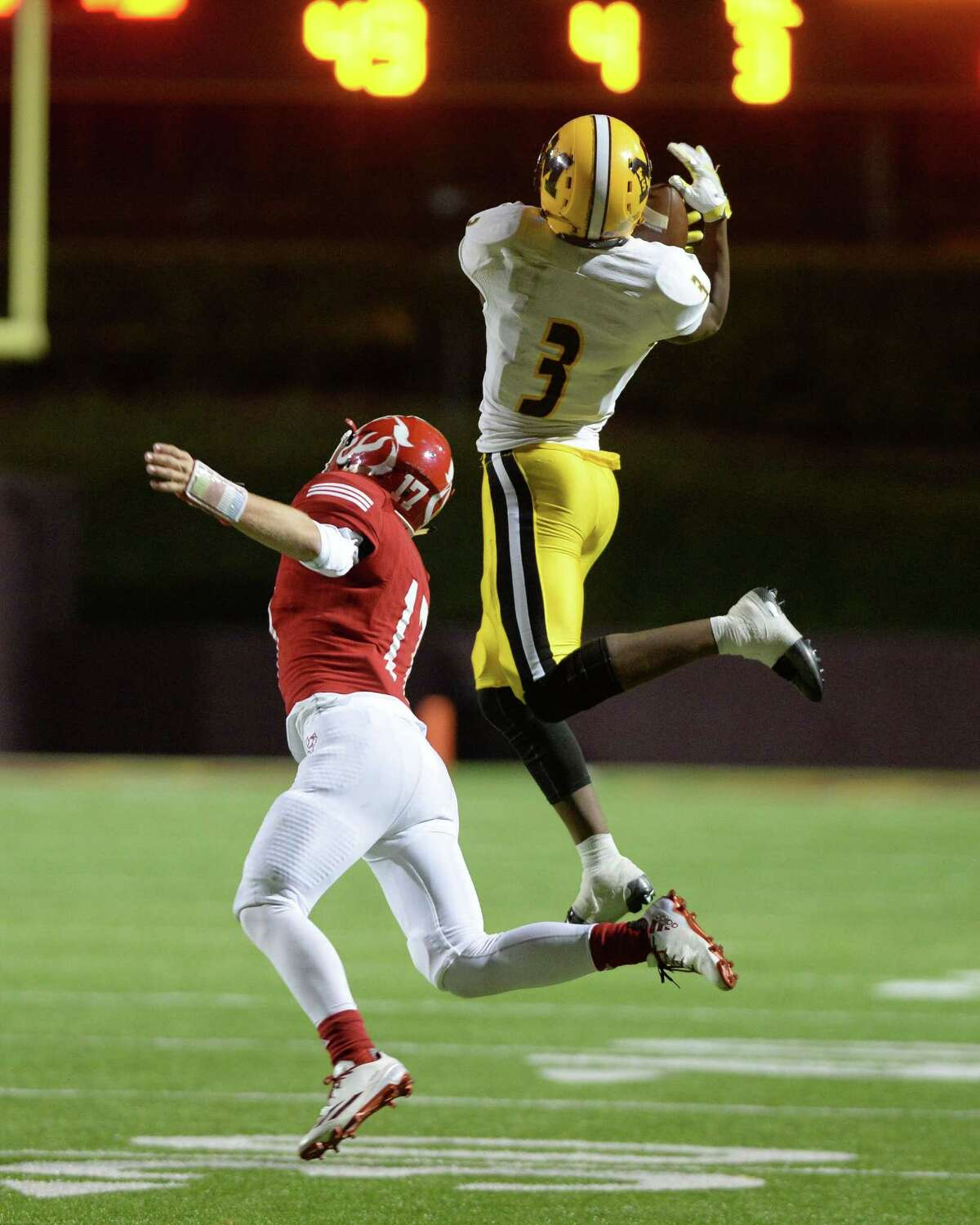 Henry Thomas (3) of Marshall leaps for a touchdown reception in the fourth quarter of a 5A Region III Division 2 playoff game between the Ft. Bend Marshall Buffalos and the Crosby Cougars on Friday November 18, 2016 at Abshire Stadium, Deer Park, TX.