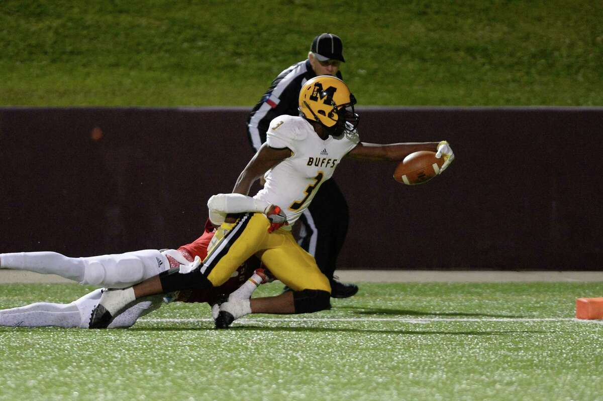 Henry Thomas (3) of Marshall dives for a touchdown in the third quarter of a 5A Region III Division 2 playoff game between the Ft. Bend Marshall Buffalos and the Crosby Cougars on Friday November 18, 2016 at Abshire Stadium, Deer Park, TX.