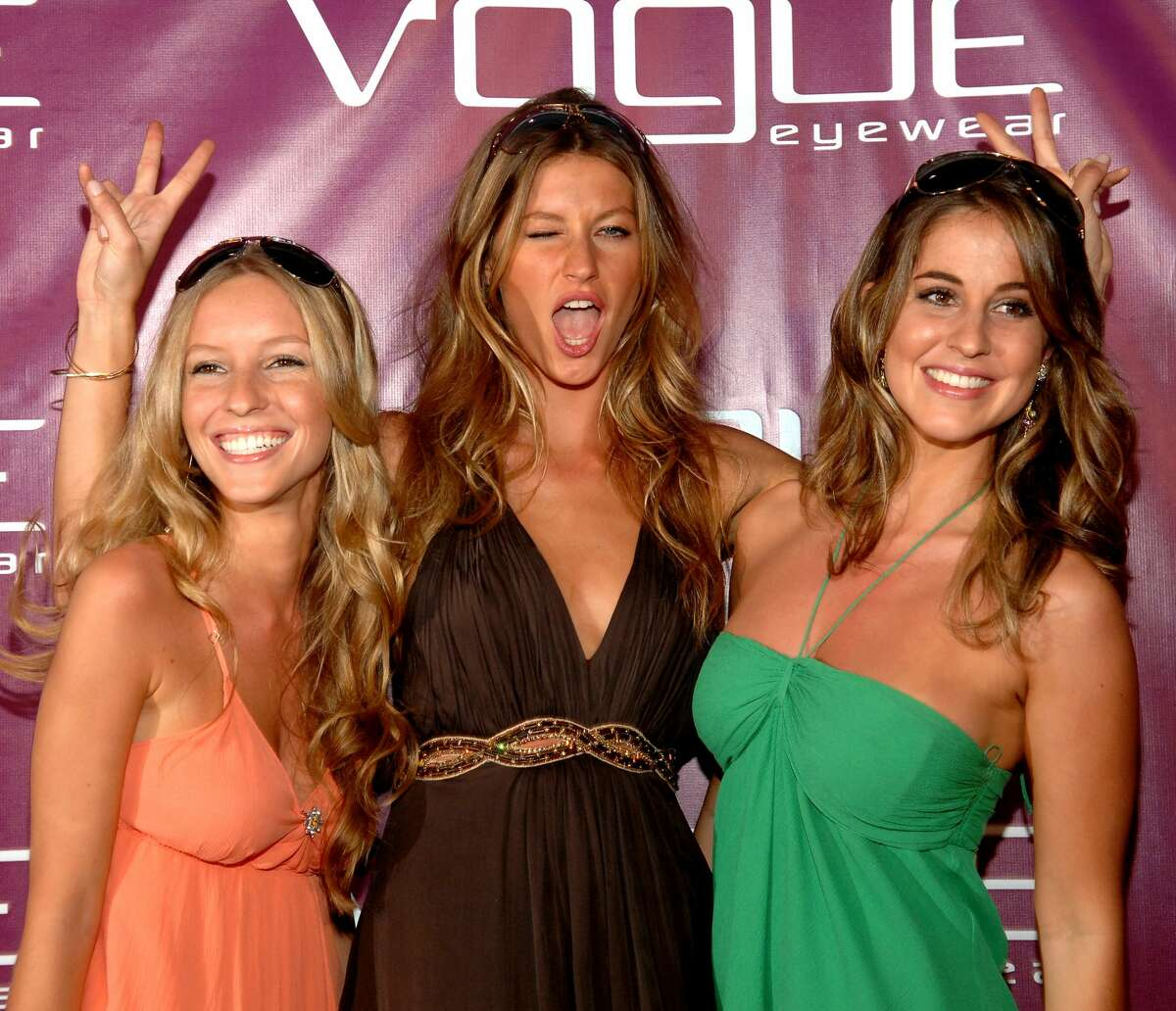 MIAMI, FL - MARCH 29 : Model Gisele Bundchen with her sisters at the Vogue Fantasy Chic Shack Beach Party at Tottem Gardens on March 29, 2007 in Miami , Florida. (Photo by Gustavo Caballero/Getty Images)