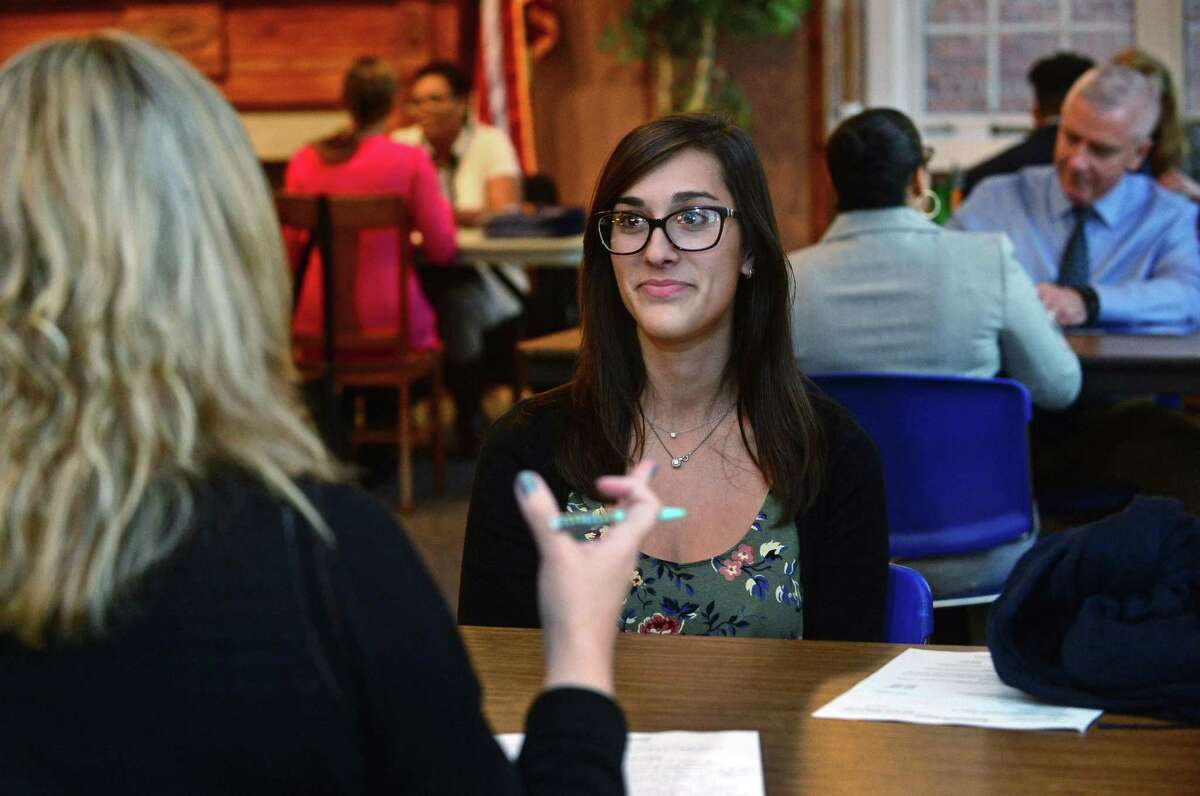 Adriana Petrucci, center, is interviewed by Special Education Administrator Kristen Mosher as dozens of candidates attend the Norwalk Public Schools' substitute teacher fair Wednesday, November 16, 2016, at Norwalk City Hall in Norwalk, Conn.