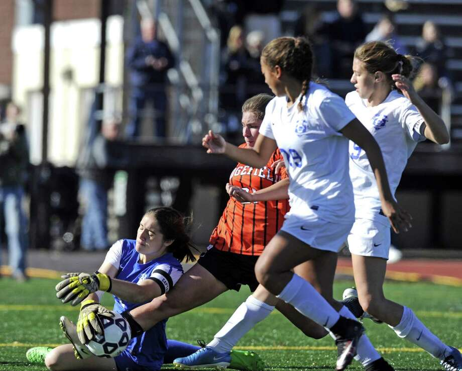 Glastonbury goalie Abigail Renaud makes a save on Ridgefield Katherine Jasminski second half goal shot in a CIAC Class LL girls soccer championship at Memorial Stadium in New Britain on Nov. 19, 2016. Glastonbury defeated Ridgefield 4-1 to win its 60th straight game and 3rd straight state championship. Photo: Matthew Brown / Hearst Connecticut Media / Stamford Advocate