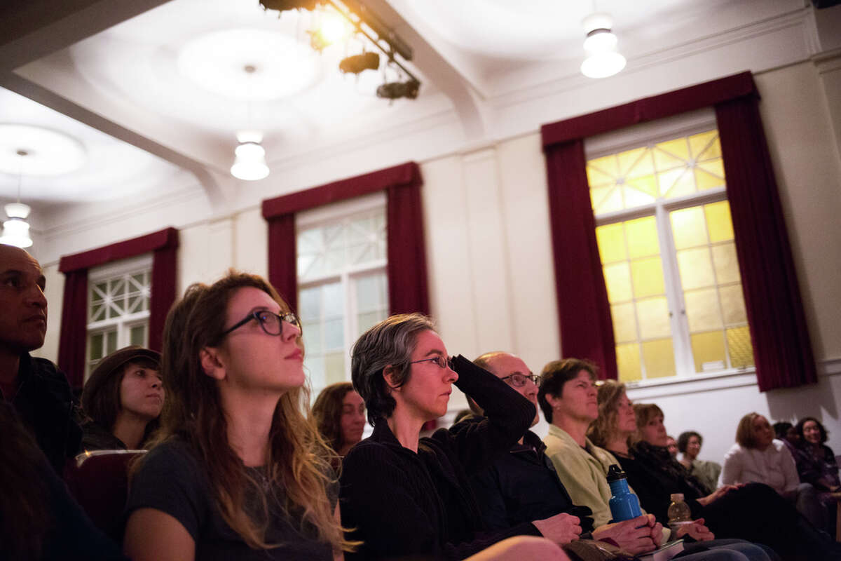 A full house listens to a panel of journalists and editors from local publications speak during What We Must Do Now, an event held by South Seattle Emerald to find direction following the election of Donald Trump, at Rainier Arts Center on Friday, Nov. 18, 2016.
