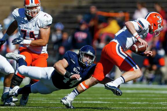 Rice Owls defensive end Brian Womac (44) sacks UTEP Miners quarterback Ryan Metz (12) as the Rice Owls take on the UTEP Miners at Rice Stadium Saturday, Nov. 19, 2016 in Houston.