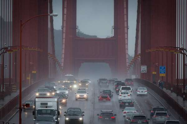Cars make a slow drive across  the Golden Gate while rain falls throughout the Bay Area Saturday afternoon, November 19, 2016 in San Francisco, Calif. Brian Feulner, Special to the Chronicle
