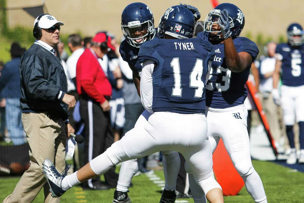 Rice Owls quarterback Jackson Tyner (14) celebrates after catching a pass for a touchdown during a double reverse as the Rice Owls take on the UTEP Miners at Rice Stadium Saturday, Nov. 19, 2016 in Houston.