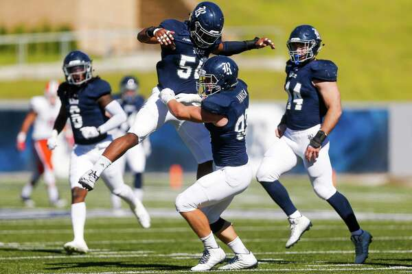 Rice Owls linebacker Emmanuel Ellerbee (58) congratulates defensive lineman Parker Hanusa (93) after sacking the quarterback as the Rice Owls take on the UTEP Miners at Rice Stadium Saturday, Nov. 19, 2016 in Houston.