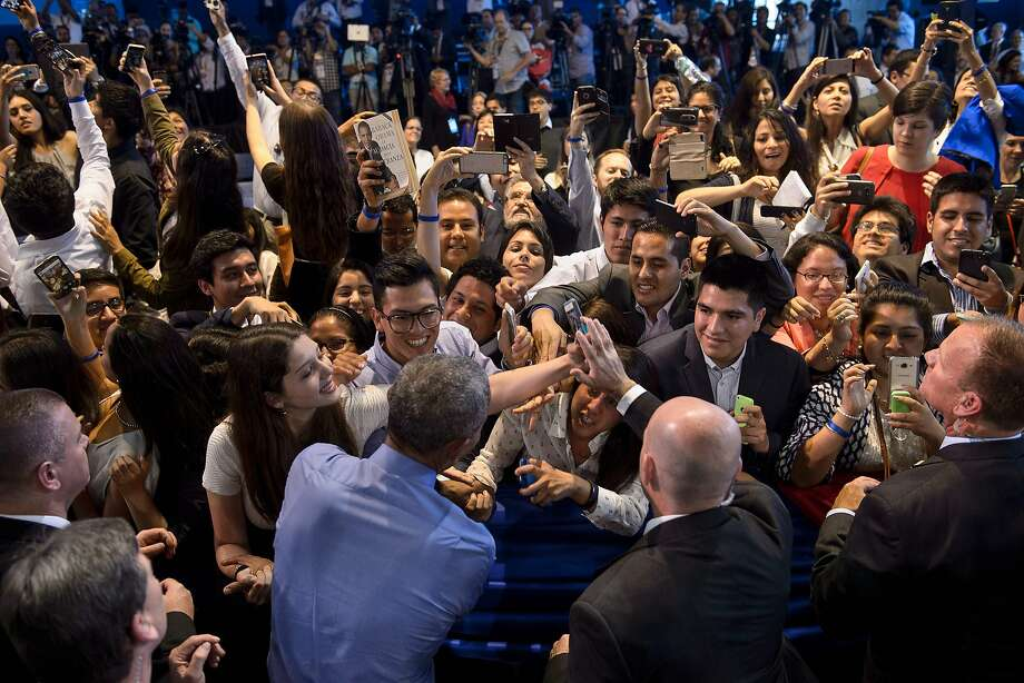 President Obama greets participants at a Young Leaders of the Americas Initiative town hall meeting at Pontifical Catholic University of Peru in Lima. Photo: BRENDAN SMIALOWSKI, AFP/Getty Images