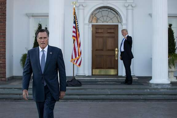BEDMINSTER TOWNSHIP, NJ - NOVEMBER 19: (L to R) Mitt Romney walks to speak to the press as President-elect Donald Trump gives the thumbs up after their meeting at Trump International Golf Club, November 19, 2016 in Bedminster Township, New Jersey. Trump and his transition team are in the process of filling cabinet and other high level positions for the new administration.  (Photo by Drew Angerer/Getty Images) *** BESTPIX ***