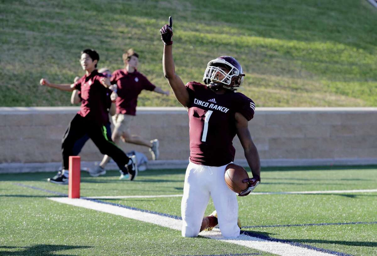 Nov. 19: Cinco Ranch 29, Langham Creek 21 Cinco Ranch Cougars wide receiver Greg Williams Jr. (1) points skyward after scoring a touchdown in the fourth quarter during the high school playoff football game between the Langham Creek Lobos and the Cinco Ranch Cougars at Tully Stadium in Houston, TX on Saturday, November 19, 2016. The Cougars defeated the Lobos 29-21.