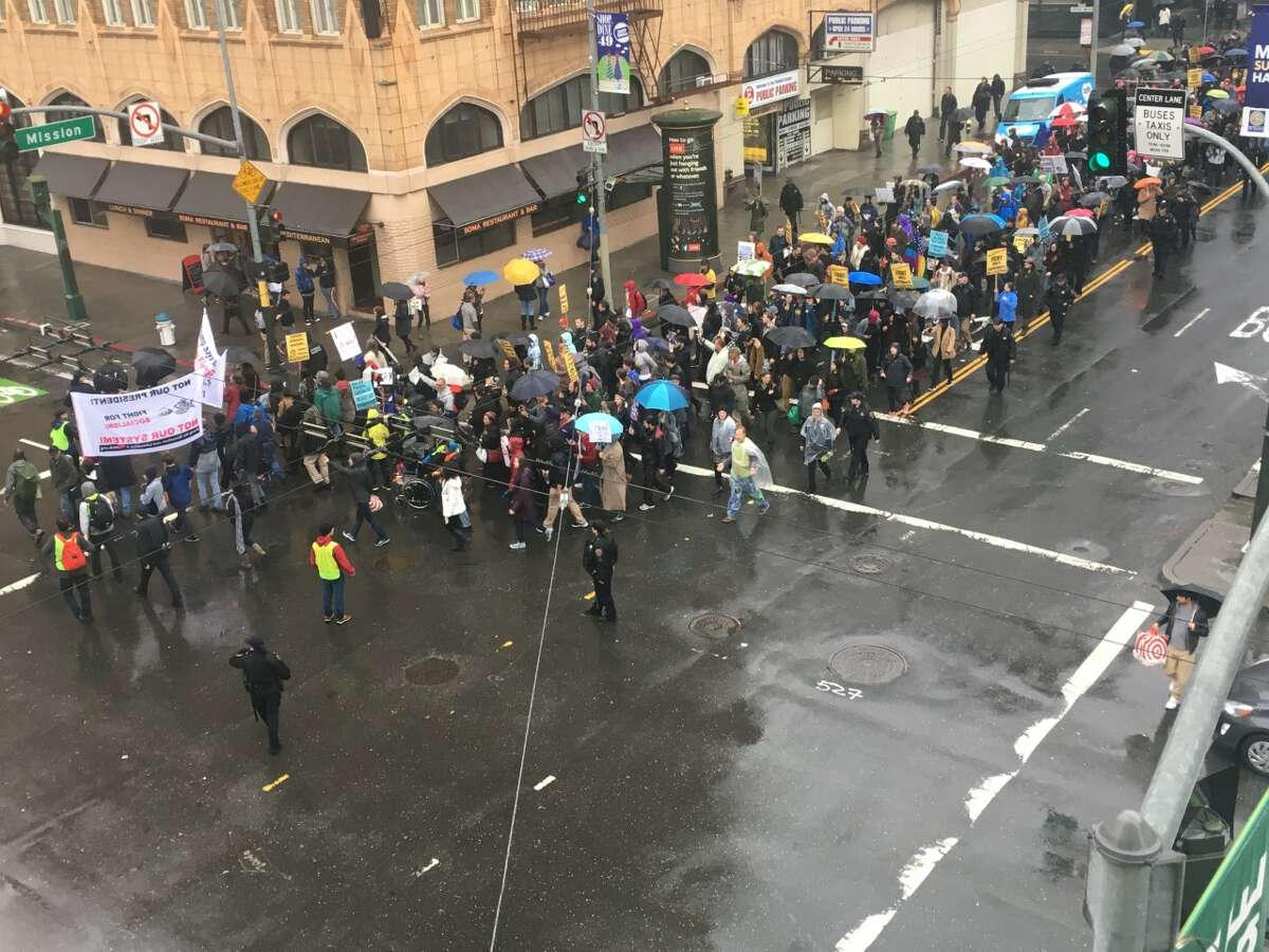 An anti-Trump protest makes it's way to Market St. in San Francisco on November 19, 2016.