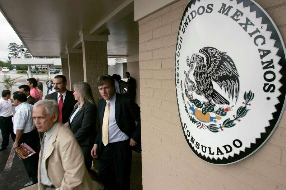 FILE - Visitors walk from the Mexican Consulate in Little Rock, Ark., after the grand opening of the building in this Wednesday, April 25, 2007 file photot. The Mexican government on Thursday Jan. 15, 2015 will start issuing birth certificates to its citizens at consulates in the United States, seeking to make it easier for them to apply for U.S. work permits, driver's licenses and protection from deportation. (AP Photo/Danny Johnston, File) Photo: Danny Johnston, STF / AP