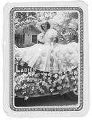 "A 1939 photo of Stella Morales Lozano, riding on the Ladies Social Club float in an unidentified parade, a good example of the Fox Photo Co.'s ""round-cornered, border prints."""