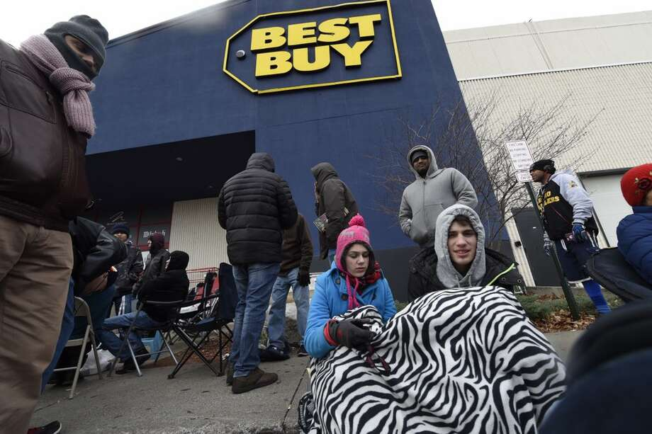 Holiday shoppers eschewed Thanksgiving celebrations in favor on waiting in line to get a jump on Black Friday sales at Best Buy, Crossgates Mall, Guilderland. Thursday, Nov. 26, 2015. (Skip Dickstein/Times Union)