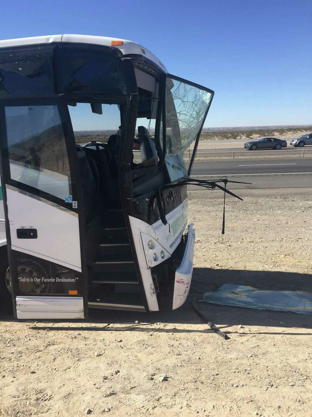 One of three busses chartered by Texas State shows damage Saturday after an accident on the Texas and New Mexico border. Five people were transported to an area hospital. The busses, carrying the Texas State football team, cheerleaders and support staff was en route to a football game at New Mexico State.