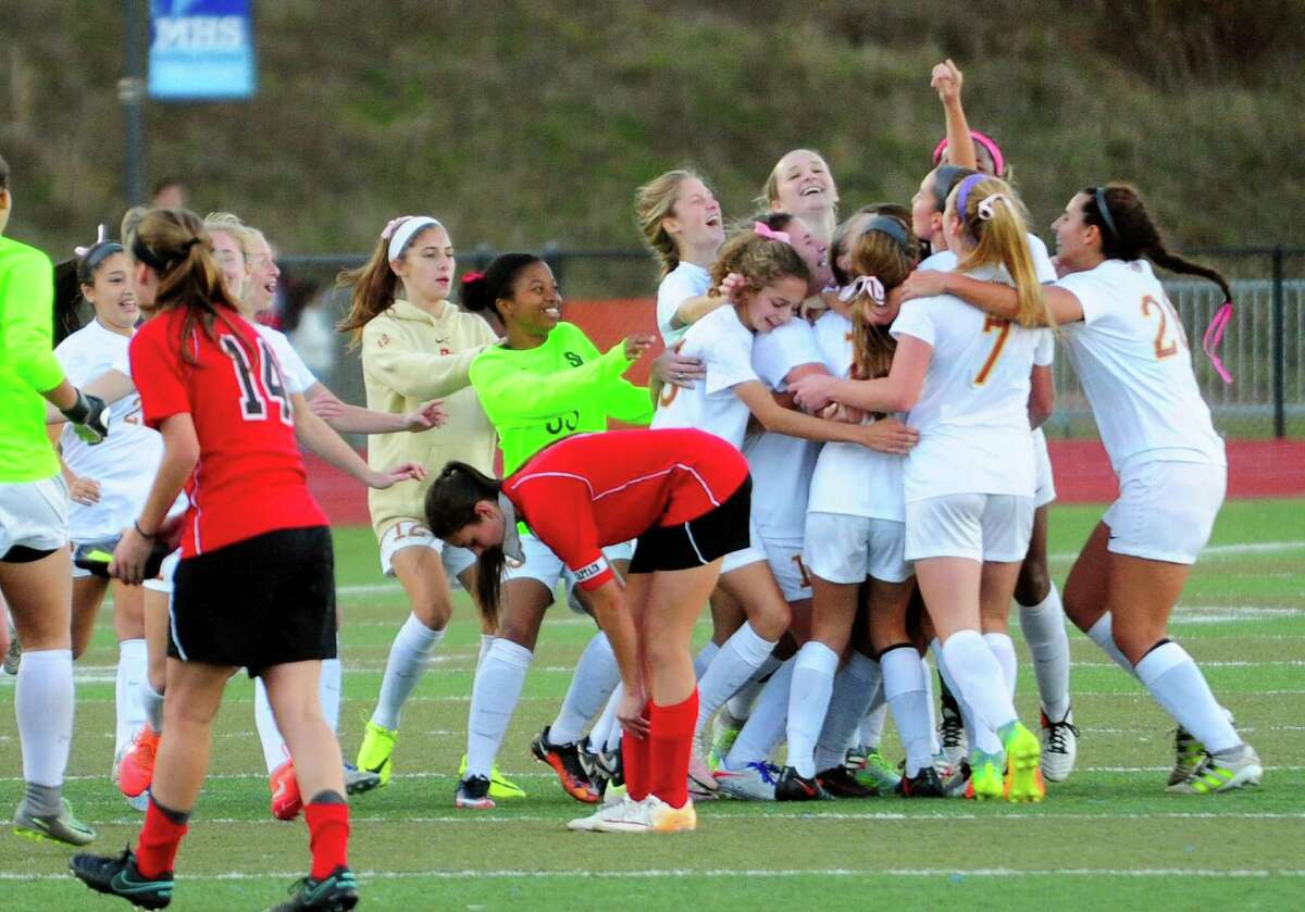 St. Joseph's celebrates its win over Masuk in Class L girls soccer championship action in Middletown, Conn., on Saturday Nov. 19, 2016.