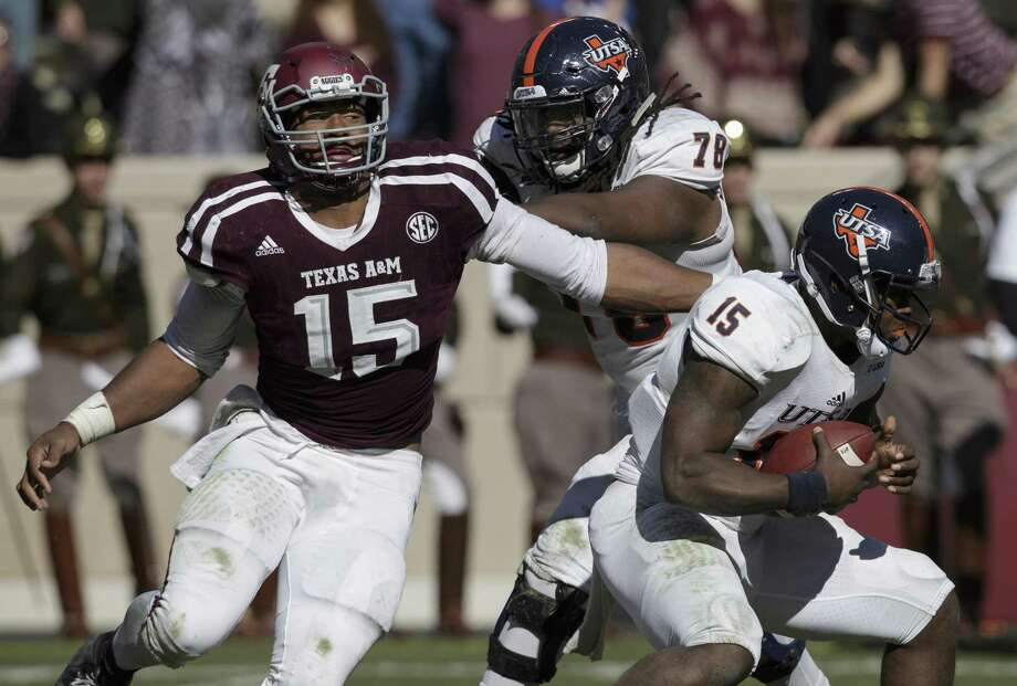 Texas A&M defensive lineman Myles Garrett (15) makes a one-handed sack as he pulls down UTSA quarterback Jared Johnson (15) during the third quarter of an NCAA college football game Saturday, Nov. 19, 2016, in College Station, Texas. (AP Photo/Sam Craft) Photo: Sam Craft, FRE / Associated Press / AP