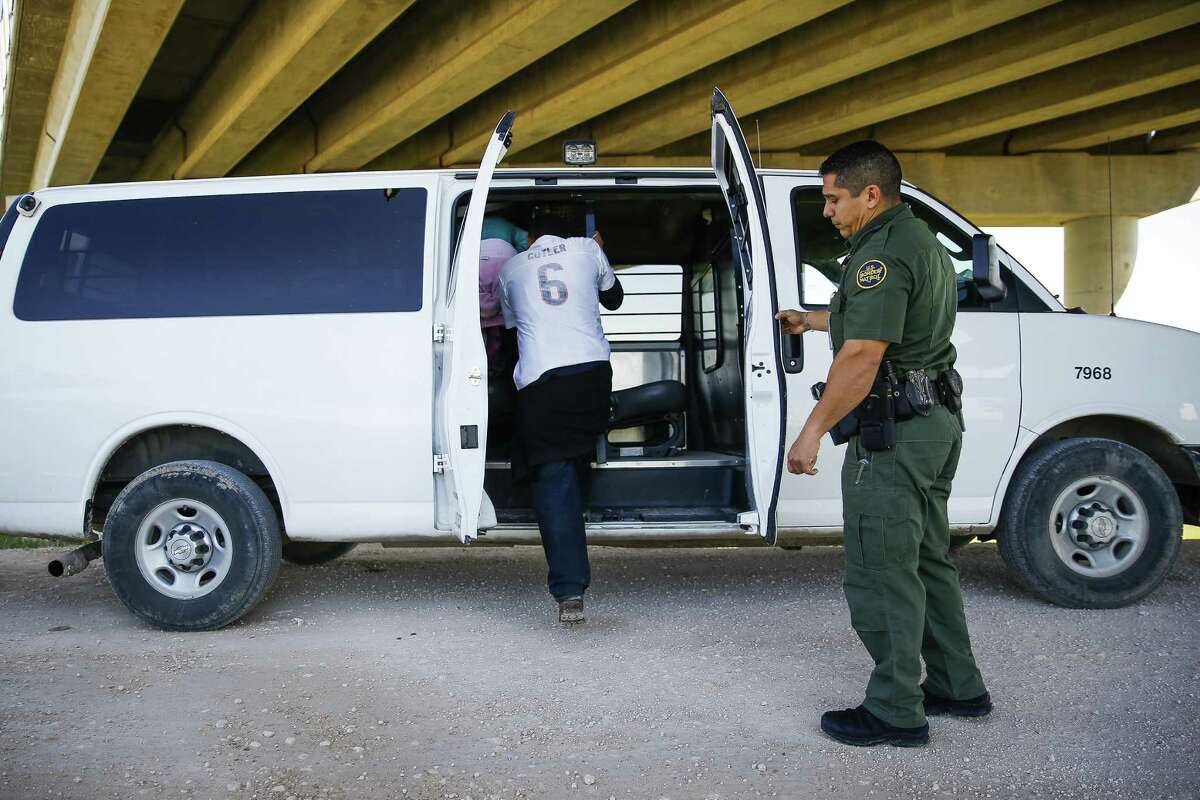 Border Patrol Agent Isaac Villegas loads immigrants for process ing in McAllen. The Obama administra tion has relied heavily on a strategy of deporting immigrants it finds in jails and prisons.