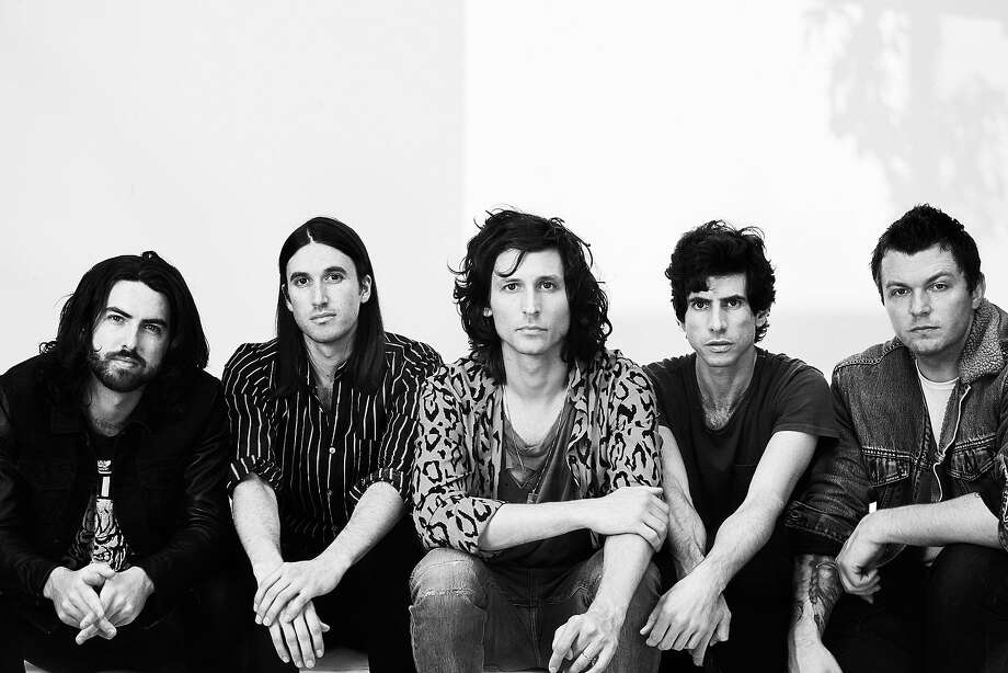 Nick Valensi (center) of the Strokes fronts CRX. Photo: BB Gun PR
