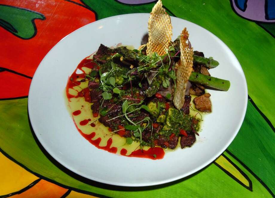 Brasitas - StamfordLatin infusion cuisineClick here for the menuPictured: Churrasco Cubano, which is grilled skirt steak with habana black bean-mashed potatoes, sauteed mushrooms, asparagus, and grilled avocado chimichurri. Photo: Christian Abraham / Connecticut Post