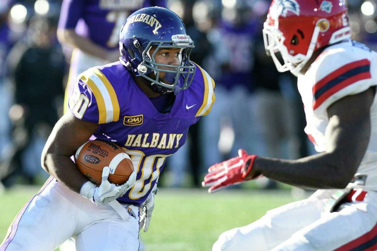 UAlbany's Kendall Rodgers Jr., left, charges for the end zone during their football game against Stony Brook on Saturday, Nov 19, 2016, at Casey Stadium in Albany, N.Y. (Cindy Schultz / Times Union)