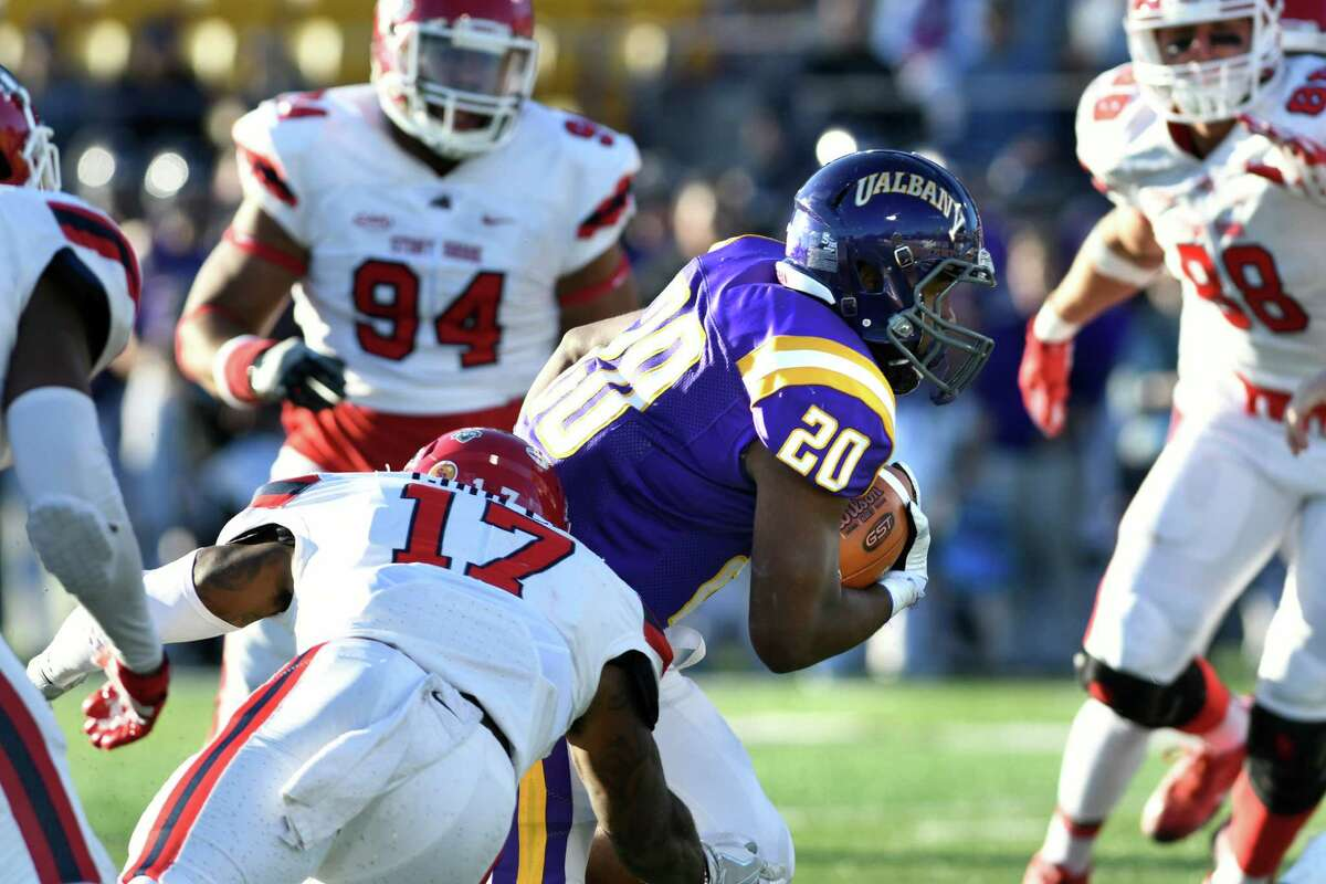 UAlbany's Kendall Rodgers Jr., center, charges for the end zone during their football game against Stony Brook on Saturday, Nov 19, 2016, at Casey Stadium in Albany, N.Y. (Cindy Schultz / Times Union)