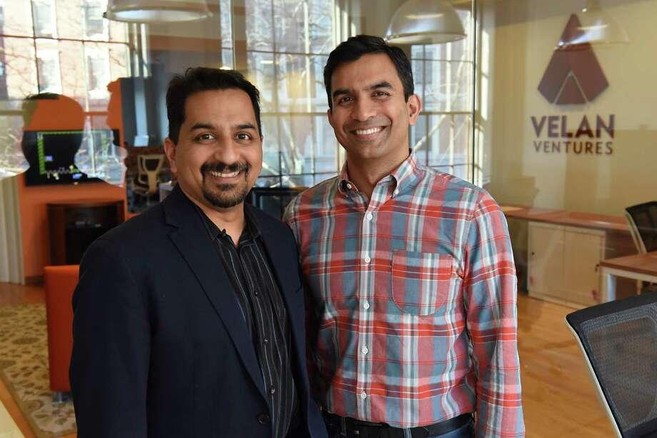 Velan Ventures CEO Karthik Bala, left, and President Guha Bala stand in the conference room at Velan Ventures on Friday, Nov. 18, 2016 in Troy, N.Y. (Lori Van Buren / Times Union) Photo: Lori Van Buren / 20038877A