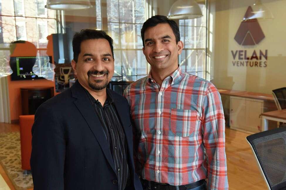Velan Ventures CEO Karthik Bala, left, and President Guha Bala stand in the conference room at Velan Ventures on Friday, Nov. 18, 2016 in Troy, N.Y. (Lori Van Buren / Times Union)