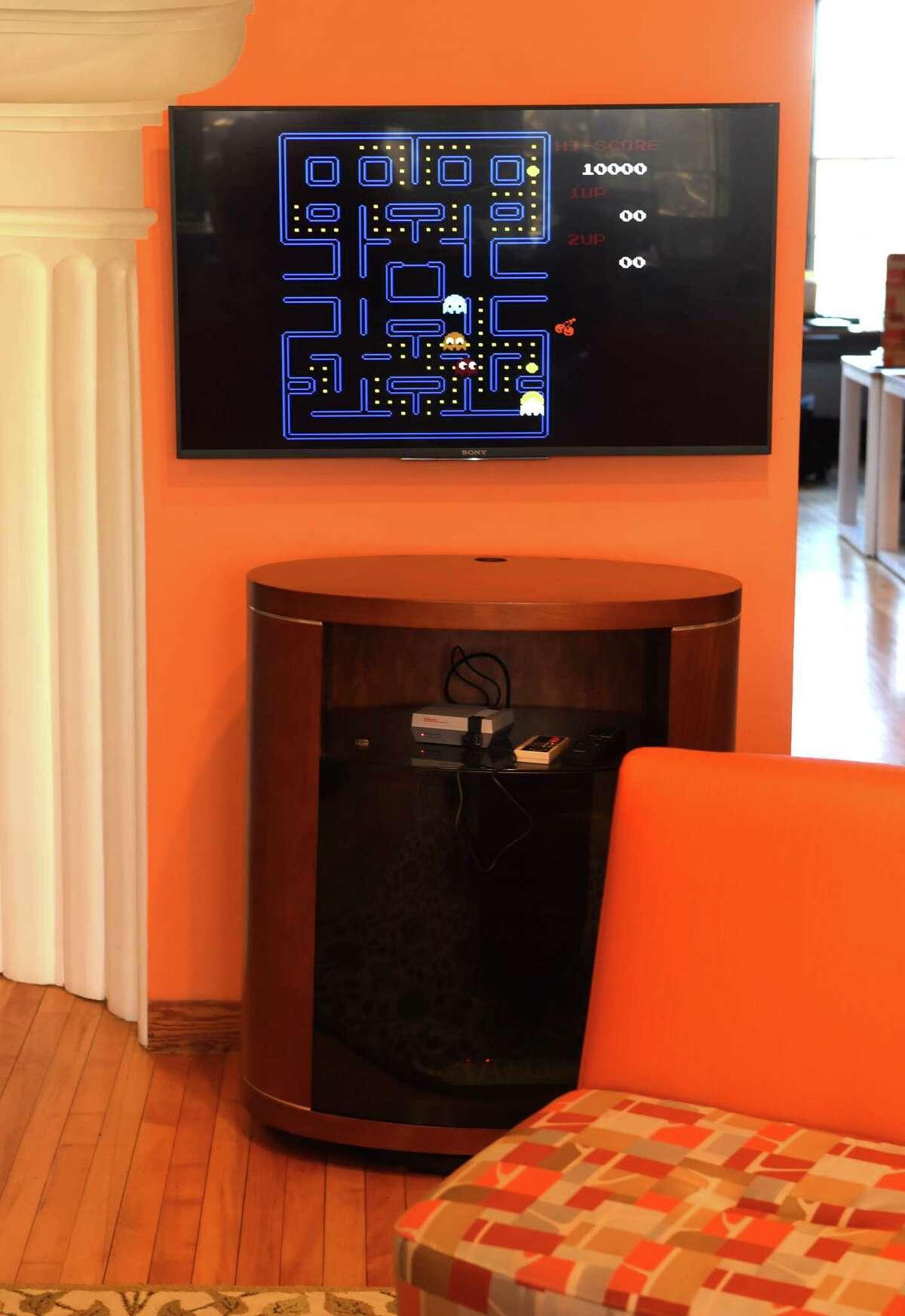 A monitor shows various video games in the lobby at Velan Ventures on Friday, Nov. 18, 2016 in Troy, N.Y. (Lori Van Buren / Times Union)