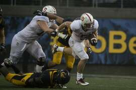 Running back Christian McCaffrey #5 of the Stanford Cardinal runs the ball during the second quarter of his game against the California Golden Bears at Kabam Field at California Memorial Stadium in Berkeley, Calif. on Saturday, Nov. 19, 2016.