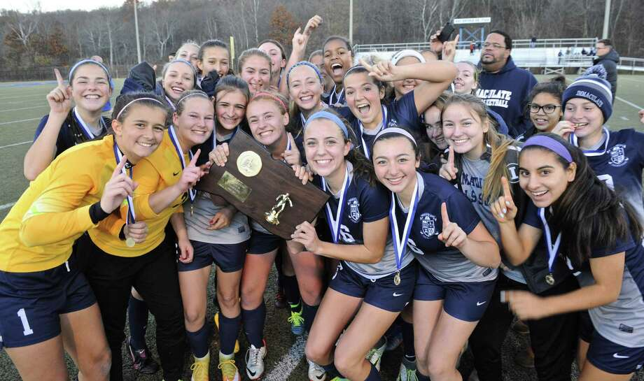 Immaculate celebrates sharing the Class M state championship after battling to a scoreless draw with Notre Dame of Fairfield Saturday in Waterbury. It's the 12th state title for the Immaculate program. Photo: H John Voorhees III / Hearst Connecticut Media / The News-Times