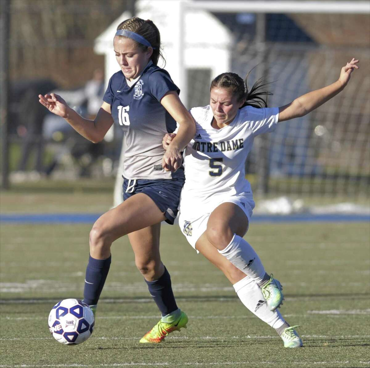Immaculate's McKinsey Jarboe (16) and Notre Dame's Erika Quinones (5) battle for the ball in the girls high school Class M soccer state championship game between Immaculate and Notre Dame-Fairfield high schools, Saturday afternoon, November 19, 2016 on Ray Snyder Sr. Field, in Waterbury, Conn. Both teams were names co-champions after battling to a 0-0 in regulation and overtime.