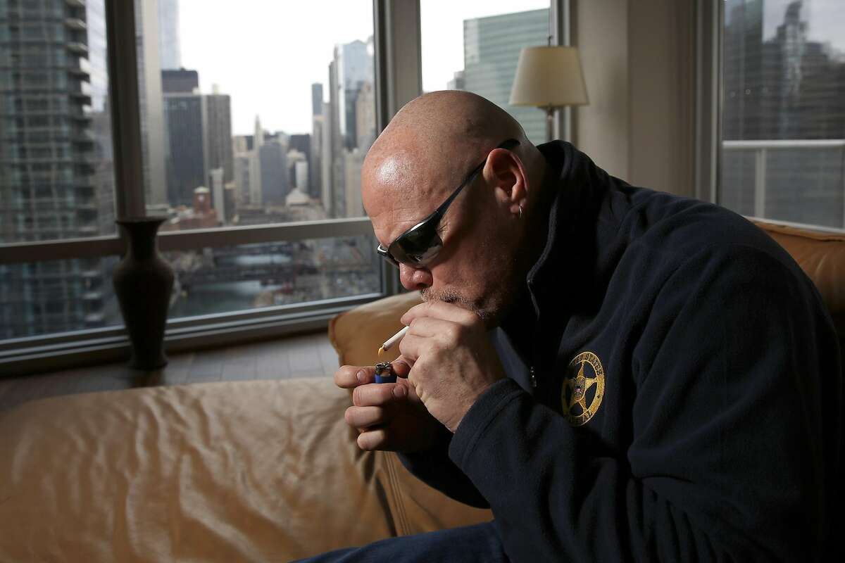 """In this Jan. 28, 2016 photo, former Chicago Bears quarterback Jim McMahons smokes medical marijuana in Chicago. McMahon calls himself """"old school,"""" including his use of marijuana both during and after his career. Yet McMahon�s stab at self-medicating could turn out to be ahead of its time. If a compound found in hemp _ and its notorious cousin, cannabis _ proves as effective in treating brain injuries as testimonials claim, it would also be welcome news for the NFL on concussions, and even better for players. (Jose M. Osorio/Chicago Tribune via AP)"""