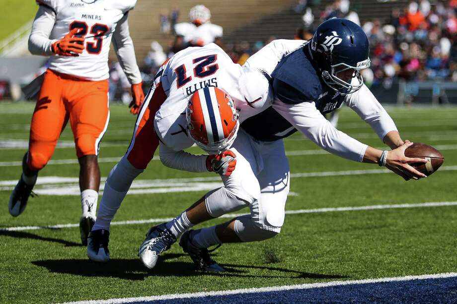 Rice quarterback Jackson Tyner dives for a touchdown past UTEP's Dashone Smith after catching a pass during a double reverse Saturday at Rice Stadium. Tyner finished 18-of-25 for 196 yards with two touchdown passes. Photo: Michael Ciaglo, Staff / © 2016  Houston Chronicle