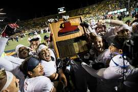 Members of the Stanford Cardinal Football team carry the Stanford Axe trophy after winning the 119th Big Game against the California Golden Bears with a score of 45-31 at Kabam Field at California Memorial Stadium in Berkeley, Calif. on Saturday, Nov. 19, 2016.